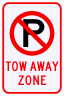 No Parking Tow Away Zone Sign with No Parking Symbol